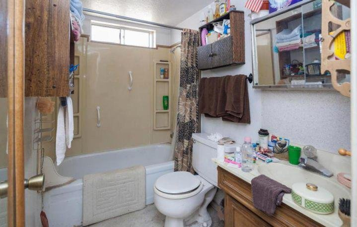 3ff3b3e8 d044 4d45 a87e cb5b18ddbfe3 piles of junk stuff belongings left behind messy cluttered bathroom phoenix arizona home house for sale attractive cluttered bathroom 8 719 x 458