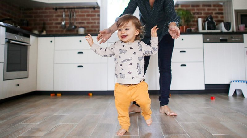 First-steps-of-a-1-year-old-baby-boy-in-the-kitchen-1296x728-header-1296x728.jpg