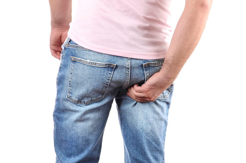 Man-In-Jeans-Scratching-Itchy-Bottom.jpg