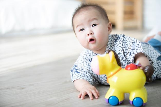 asian baby boy playing hourse toys floor 38045 103