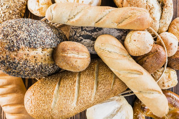 assortment-different-type-baked-breads_23-2147872517.jpg