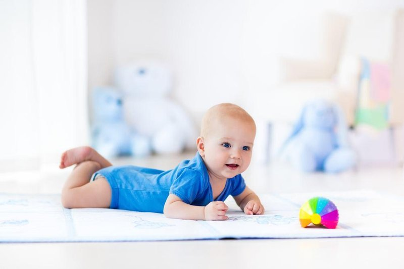 baby crawling and toy