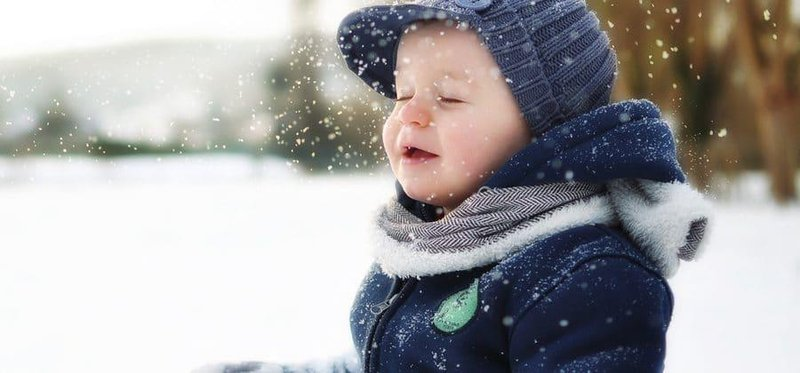 baby in snow 900x420