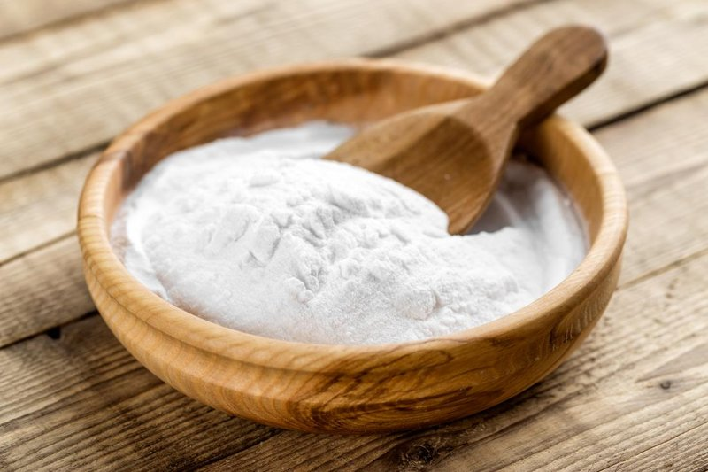 baking-soda-for-bath-in-wooden-bowl-with-wooden-spoon.jpg
