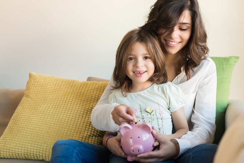 bigstock-Mom-And-Daughter-Saving-Money-109336508.jpg