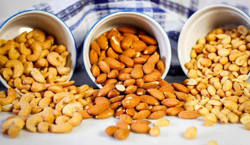bowls of nuts almonds cashews and peanuts cc marcho vercho