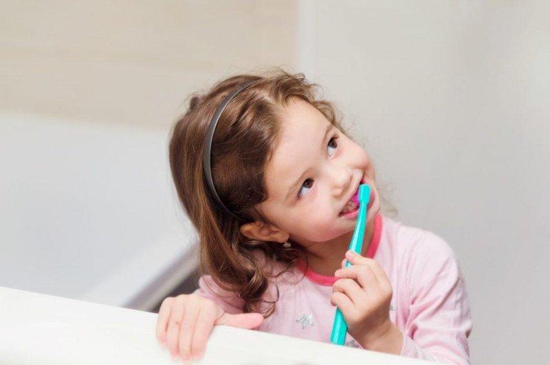 child brushing teeth 1024x681