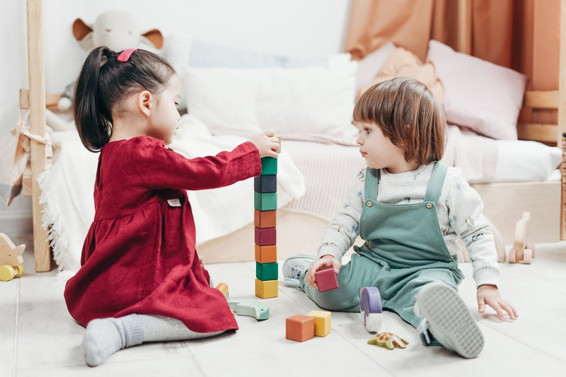 children-sitting-down-on-the-floor-playing-with-lego-blocks-3661454.jpg