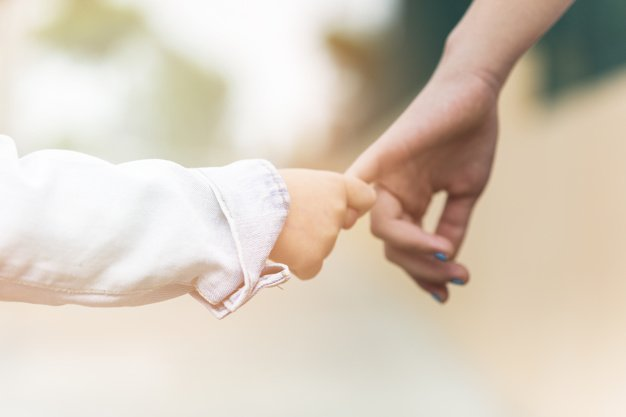 close-up-brother-holding-sister-s-finger_23-2147843542.jpg