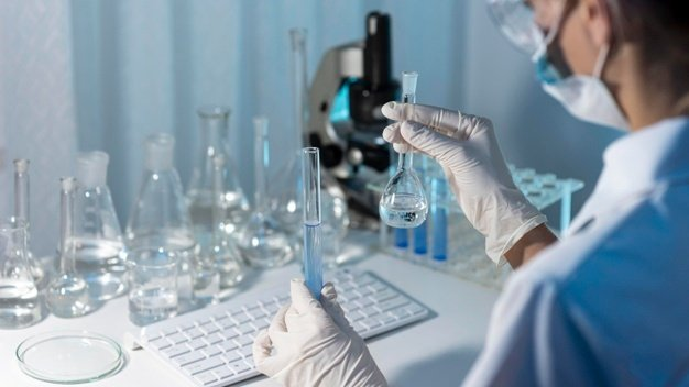close-up-researcher-holding-glassware_23-2148794430.jpg