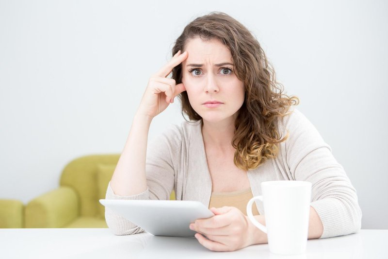 confused woman holding tablet 1500 x 1000