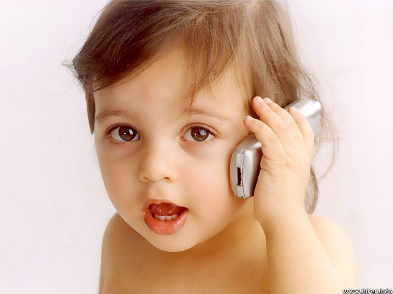 cute baby girl talking on cellphone