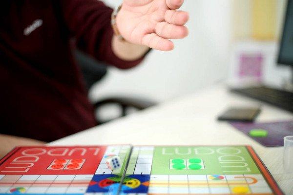 depositphotos_272248376-stock-photo-picture-man-playing-ludo-game.jpg