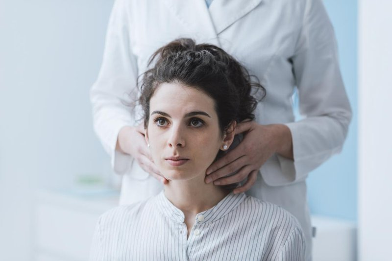 doctor-examining-female-patients-lymph-nodes.jpg