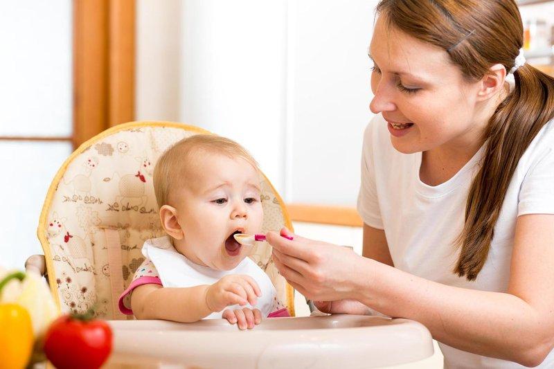 feeding juice to baby