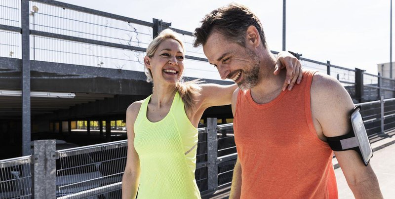 fit couple jogging in the city having fun taking a royalty free image 981616474 1544029392