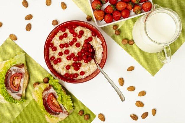 flat-lay-porridge-with-fruits-sandwiches-plain-background_23-2148267673.jpg