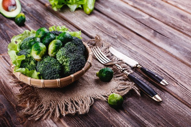 fresh-healthy-food-wooden-bowl-with-broccoli-brussel-sprouts-olive-oil-green-pepper_8353-8608.jpg