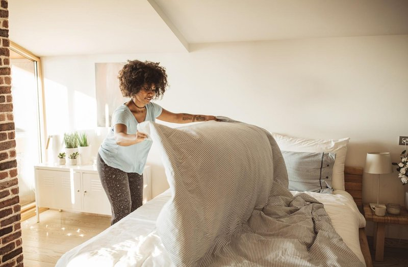 gettyimages woman making bed svetikd