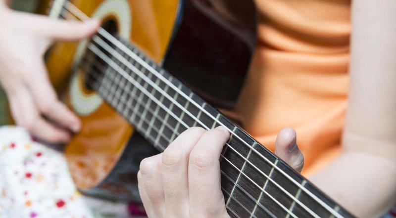 girl playing guitar 1300