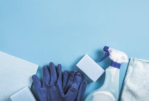 high-angle-view-spray-bottle-gloves-sponge-blue-background_23-2147860263.jpg