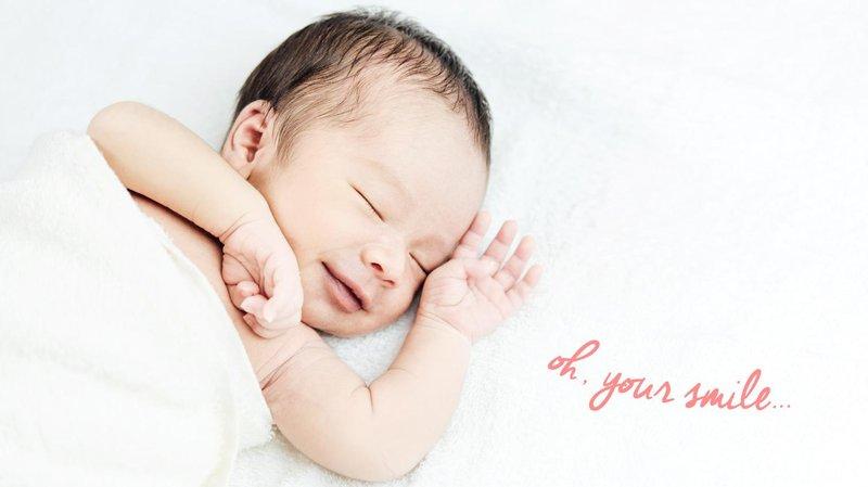 knapa bayi tersenyum saat tidur hero banner magz (1510x849)