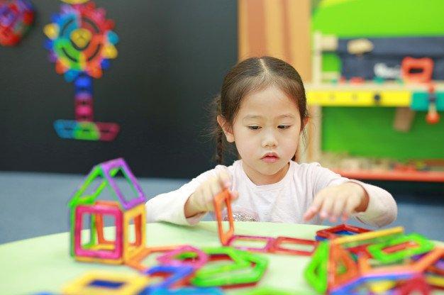 little-child-girl-playing-magnets-toy-brain-development_38678-3723.jpg