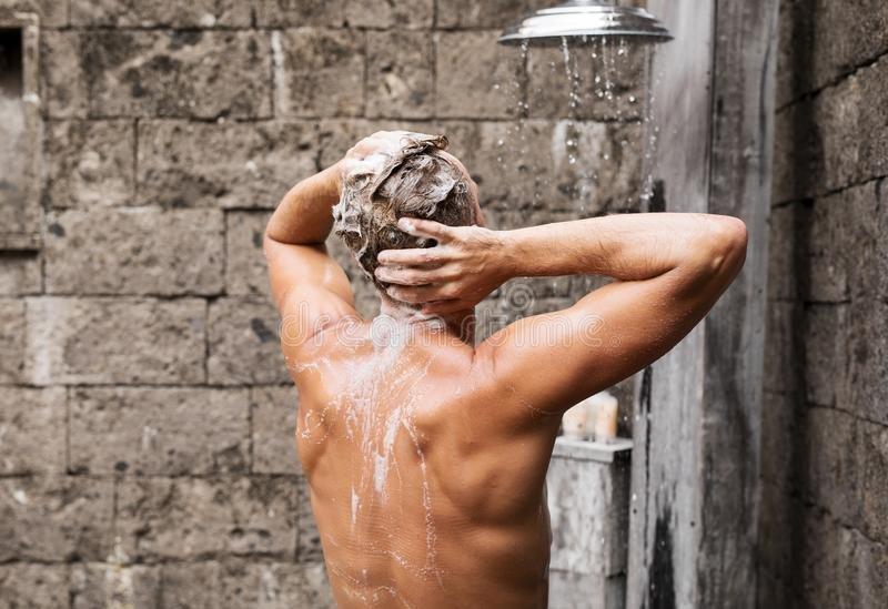man taking shower.jpg