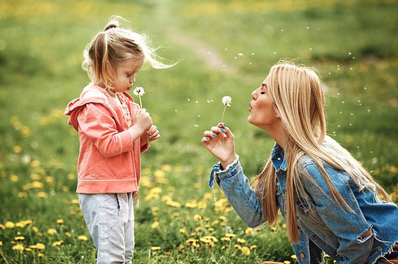 mom and daughter with dandelions 1024x682