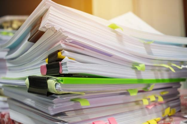 paper stack pile unfinished documents office desk related business functions 4236 161