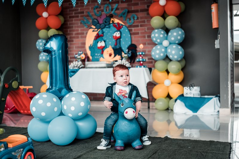 photo-of-child-sitting-on-toy-near-balloons-3653946.jpg
