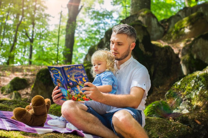 photo-of-man-and-child-reading-book-during-daytime-2801567.jpg