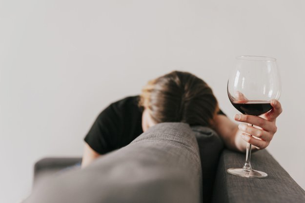 sad-woman-with-wine-couch_23-2147770835.jpg