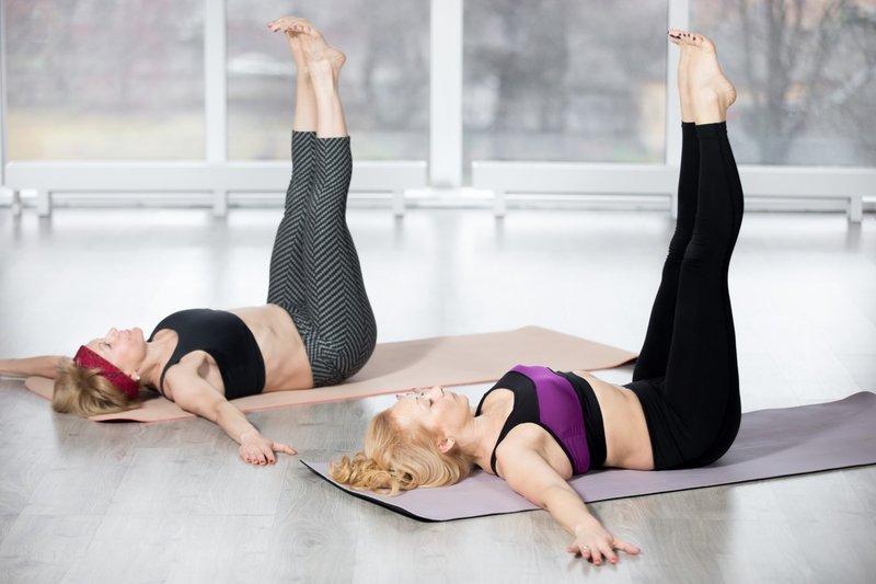 senior-women-doing-double-straight-leg-lift-exercise.jpg