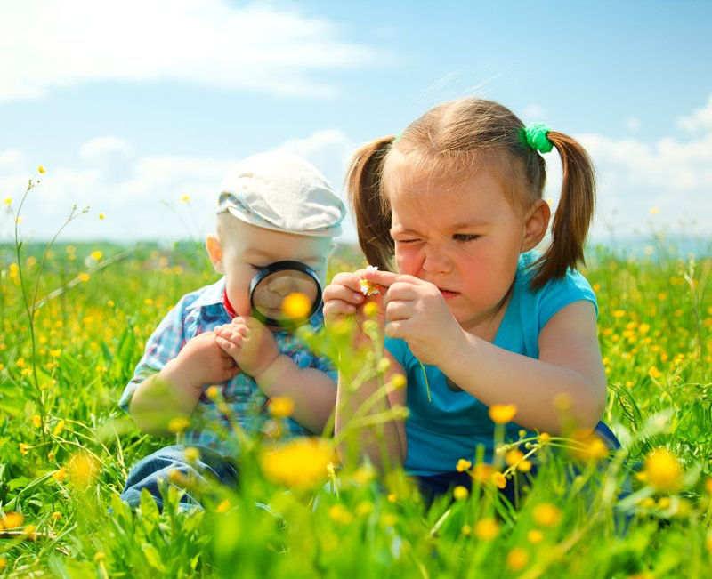 sf-children-in-field-with-magnifying-glass.jpg