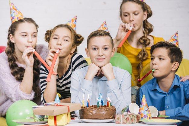 smiling-portrait-teenage-boy-celebrating-his-birthday_23-2148030019.jpg