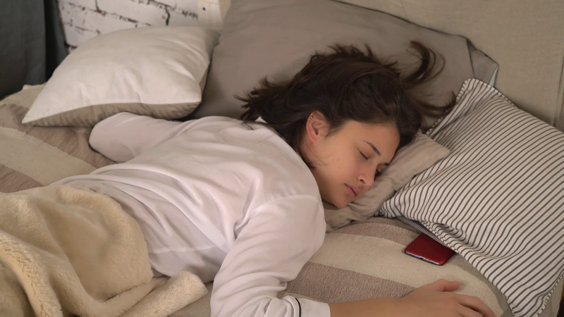 sound-of-the-alarm-clock-woke-woman-up-attractive-girl-turn-off-smartphone-and-continued-to-sleep-beautiful-woman-sleeping-in-bed-use-mobile-phone-caucasian-model-wearing-in-white-sleepwear-at-home_sl.png