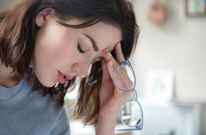 stocksy woman headache glasses jamie grill atlas
