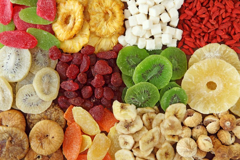 top-view-of-variety-of-dried-fruits-royalty-free-image-151531351-1533134365.jpg