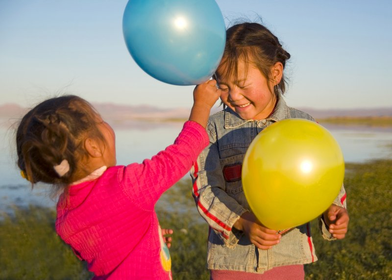 two-little-girls-playing-with-each-other-with-balloons.jpg