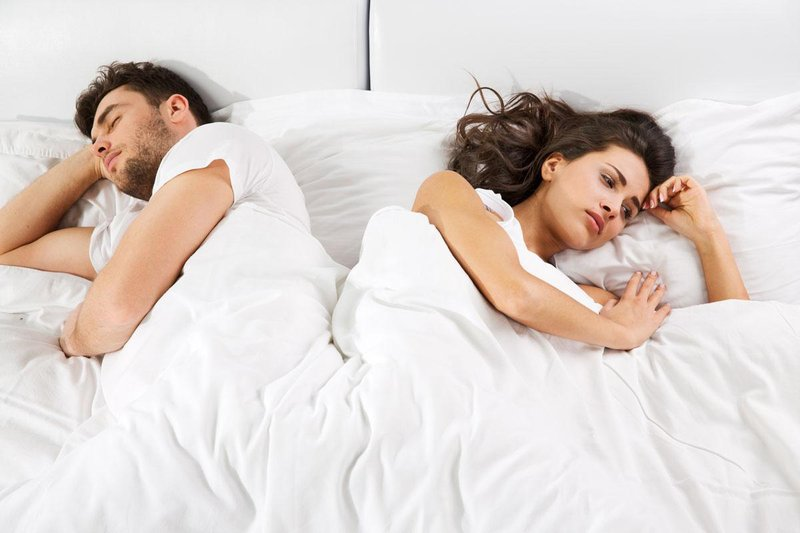 unhappy couple in bed missing intimacy
