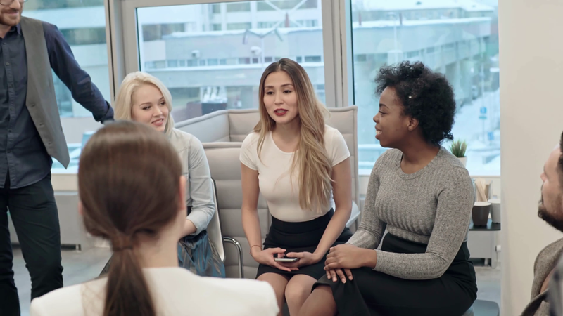 videoblocks-pan-of-group-of-laughing-businesspeople-sitting-in-circle-during-team-building-exercise-and-listening-to-asian-businesswoman-gesturing-and-telling-funny-story_h0wvubftg_thumbnail-full01.png