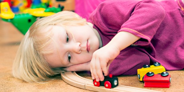 web3-bored-child-playing-trains-floor-home-shutterstock.jpg