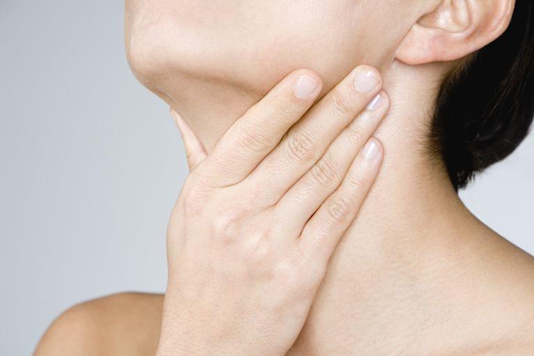 woman touching her neck 75403608 5a28d90d47c2660036cea7e0