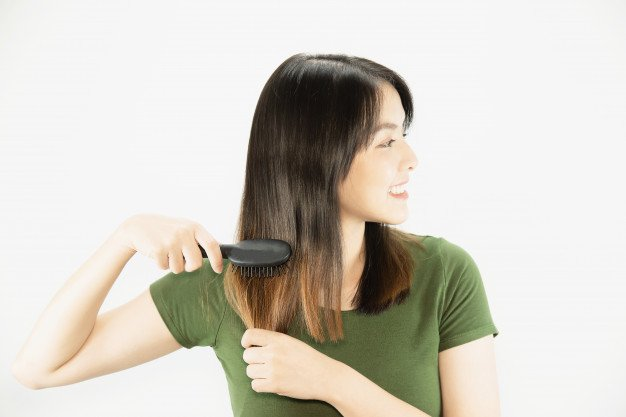 young-beautiful-lady-happy-using-comb-straight-her-hair-woman-beauty-hair-care-concept_1150-13586.jpg