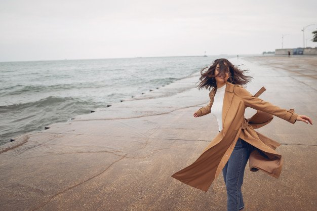 young-girl-walking-beach_1157-16812.jpg