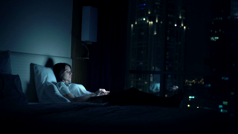 young-woman-browsing-web-on-laptop-lying-on-bed-at-home-at-night_hku4usosx_thumbnail-full01.png