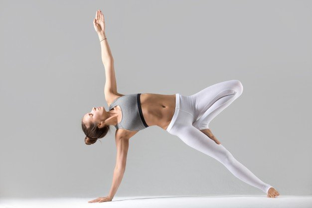 young-woman-side-plank-pose-grey-studio-background_1163-2484.jpg
