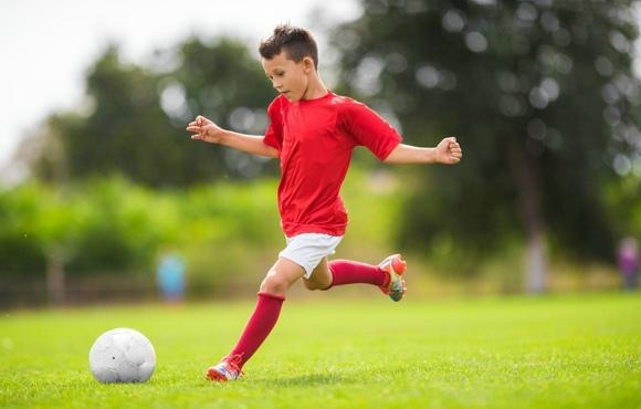 young soccer player slide 1